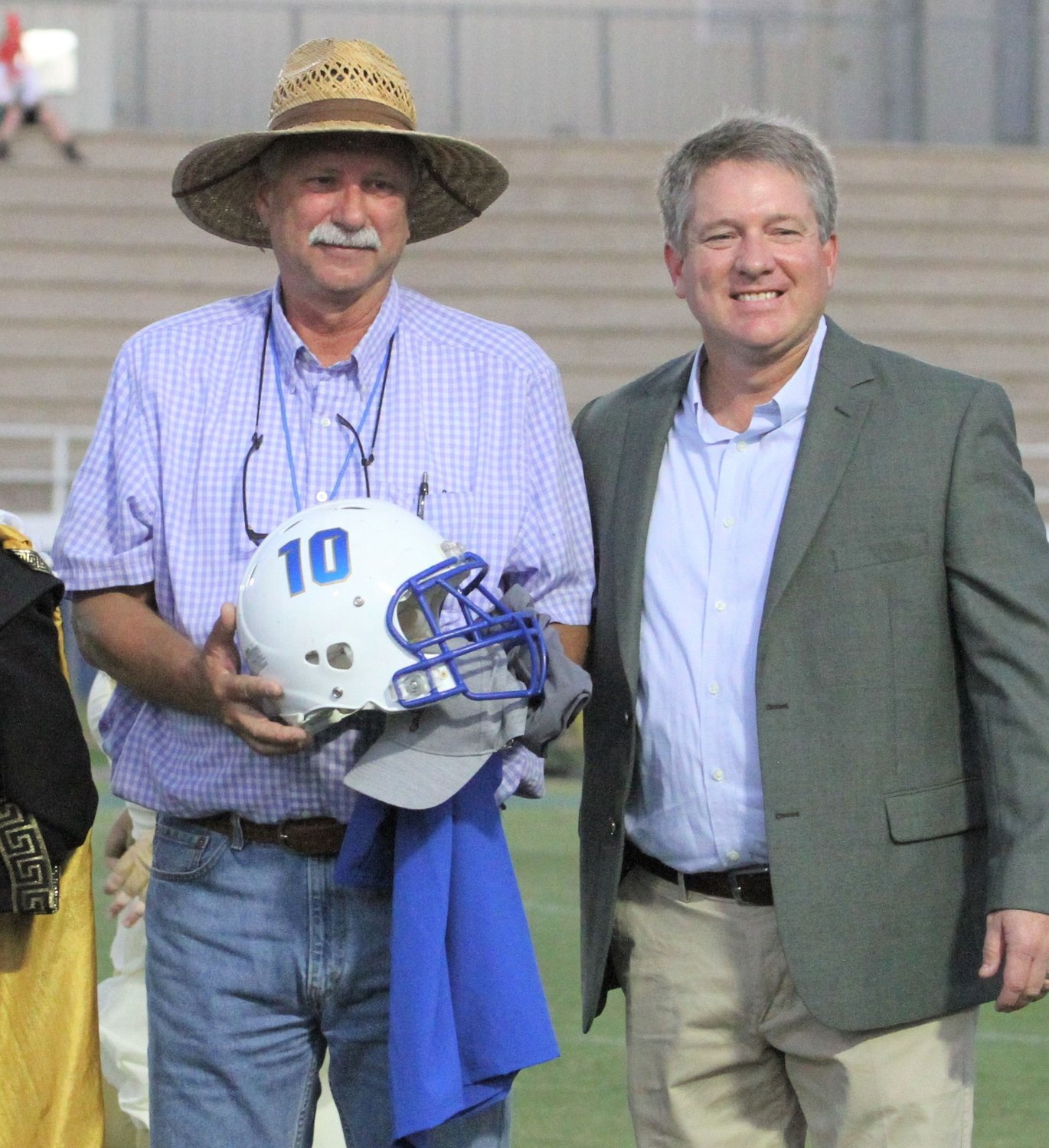 City of Fairhope Parks and Recreation Director Tom Kuhl, left, is retiring. He was recognized at the Fairhope High School football game Sept. 21. Pictured with him is Fairhope High Principal Jon Cardwell.