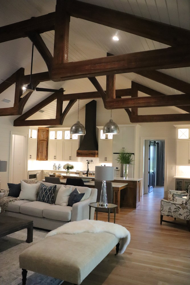 The open floor plan is spacious and awe-inspiring with its featured thick, hammered pine beams.