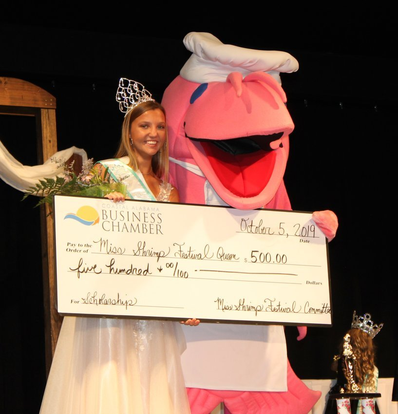 Miss Shrimp Festival 2019 Abigail Jones of Gulf Shores High School was presented with a $500 scholarship by the National Shrimp Festival mascot.