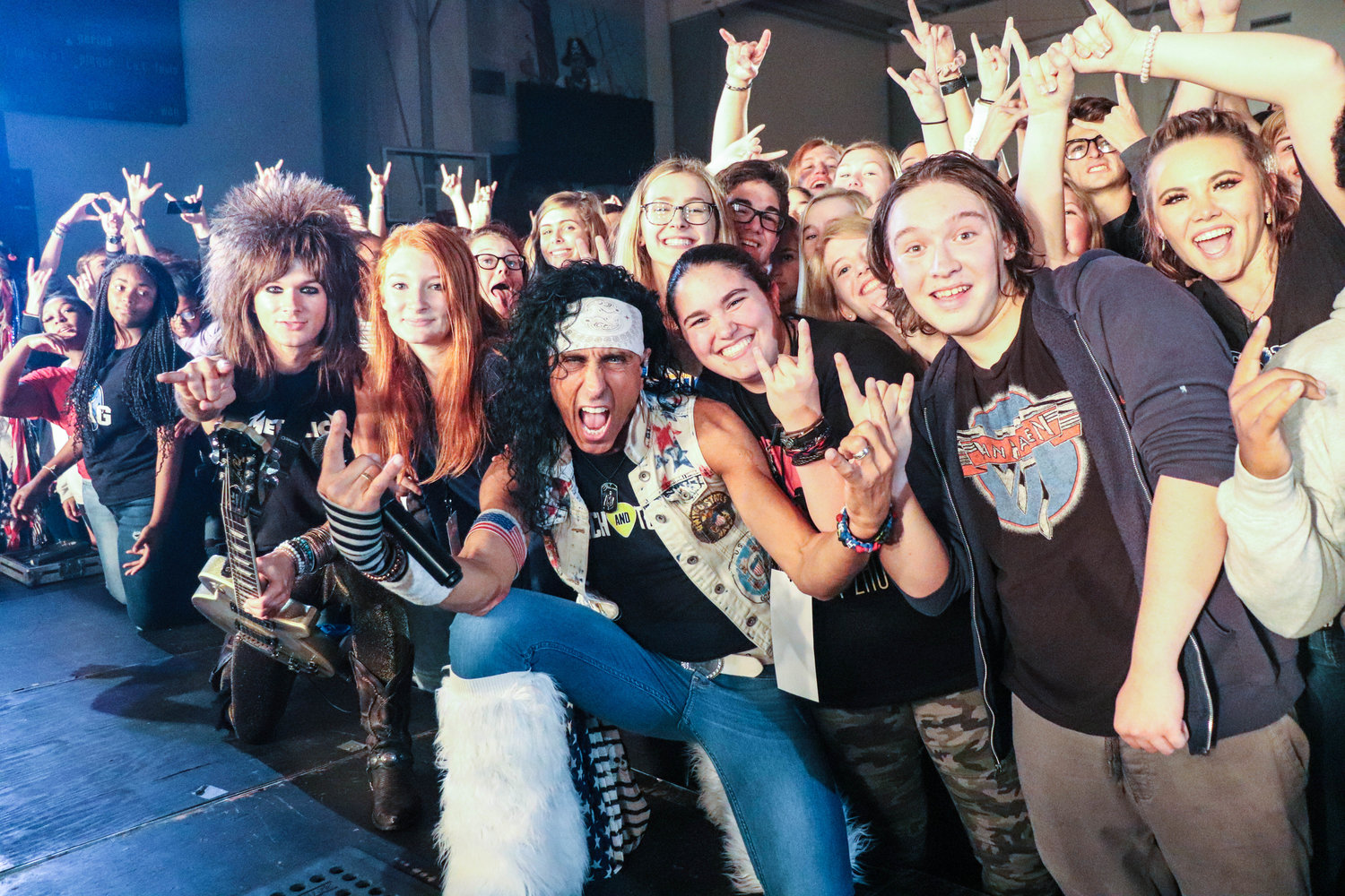 Members of the Velcro Pygmies pose with students during the show.