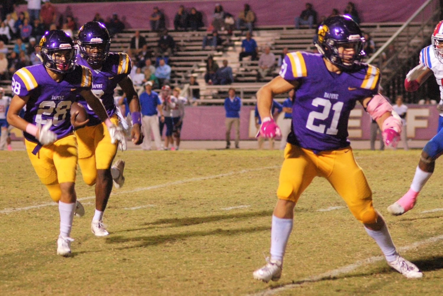 DHS quarterback Trent Battle gets lead blocking from Veontai Williams (28) and Davis Oliver (21) at Jubilee Stadium Oct. 24. The Trojans (5-4, 5-2) picked up their fifth Region 1 win. The Saints fell to 6-3, 5-2.