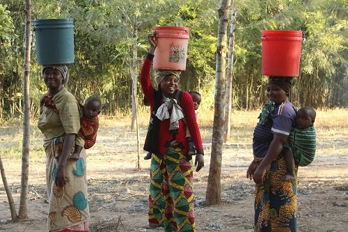 Women in the Kiteto Village in Central Tanzania take advantage of a recently finished water project by Maji Hope.