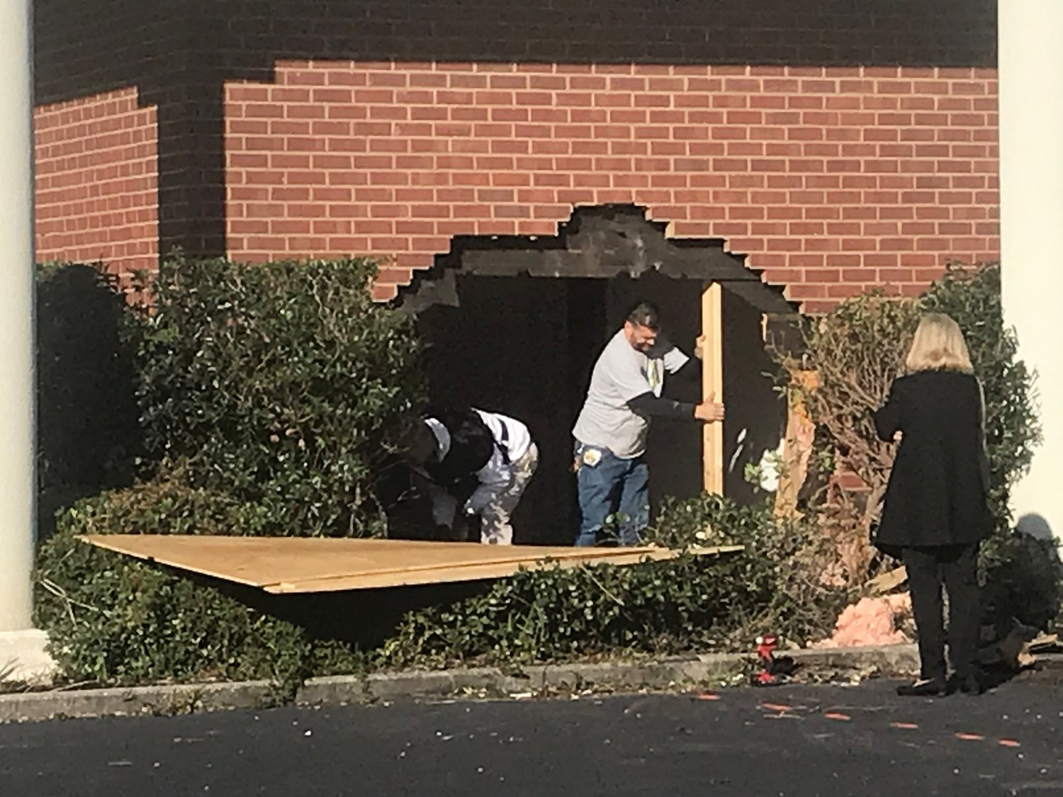 Crews begin work on Wednesday, Nov. 13 to repair damages to the Peachtree Professional Center.