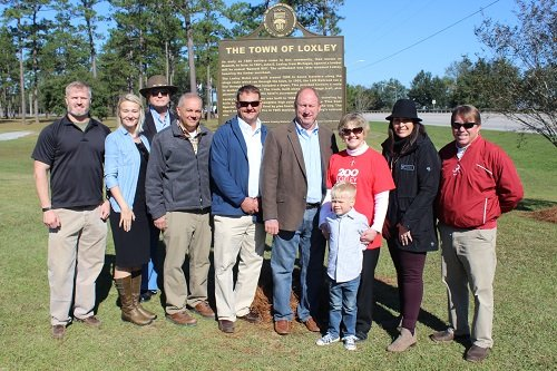 The family of John Loxley and County Commissioner Billie Jo Underwood join members of the Loxley Town Council in front of the town of Loxley's historic marker, dedicated as part of Loxley's Founder's Day celebration on Saturday, Nov. 9.