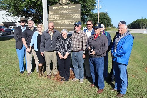 Town officials were joined by local veterans in unveiling a historic marker commemorating the Loxley POW Camp.