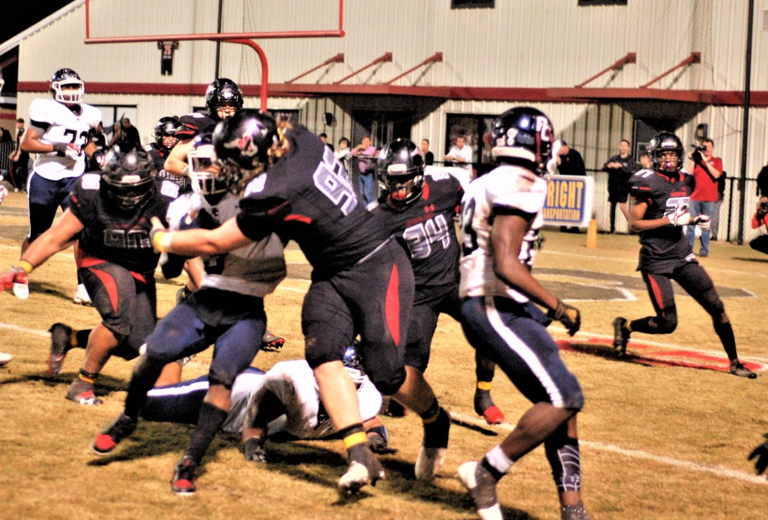 Mitchell Babbs (92), TiShun Calvin (34) and Carlos Johnson close in on Park Crossing runner Adaryl Lewis at Spanish Fort.