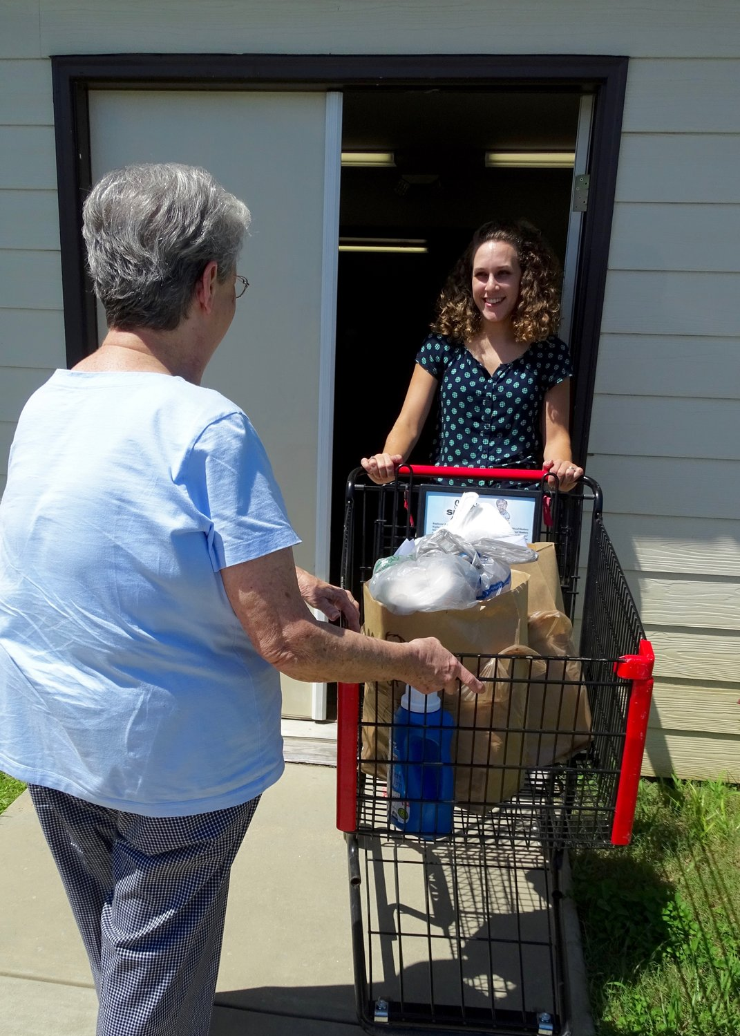 South Baldwin Director, Dana Jepsen, takes groceries out for a client at the Foley pantry.