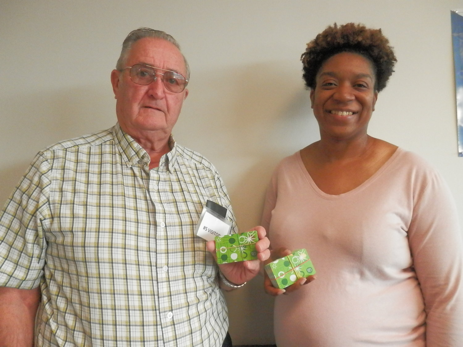 Gary Durgin, Wisconsin Sno-birds, delivers Walmart gift cards to Erica Hall, Supervisor Baldwin County Dept. of Human Resources Office of Child Welfare.
