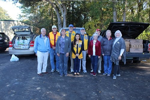 Debbie Schwoebel, second from right, members of the Fairhope Lions Club and other friends delivered 100 turkeys on Monday, Nov. 25 to Catholic Social Services Baldwin County Director Phyllis Beam, far right, in Robertsdale.