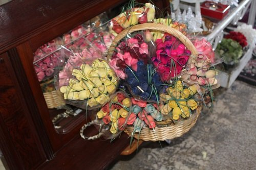 One of the more popular items right now are the Tea Wooden Roses, hand-painted wooden roses that look like the real thing.
