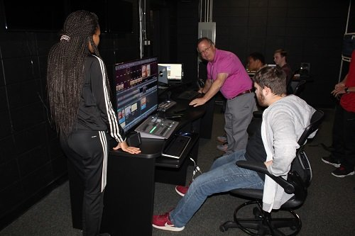 Instructor Michael Bland and student from the South Baldwin Center for Technology's TV production class work on an assignment.