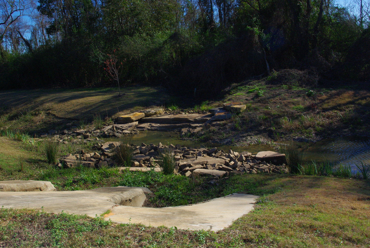Rock formations are part of the environmental project at Wells Road in Daphne. The rocks slow water flow, reducing erosion.