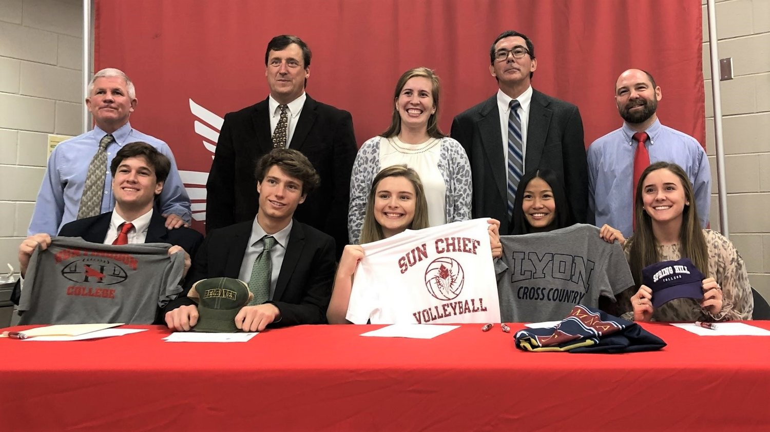Seated, from left: Grant Murray, Football, Huntington College; Anthony Lazarri, Soccer, Belhaven University; Caitlyn Bushaw, Volleyball, Coastal Community College; Allison Boyd, Cross Country, Lyon College; Sydney Barter, Basketball, Springhill College. Standing, from left to right: Coach Phelps, Coach Knapstein, Coach Williams, Coach Hall, Coach Offerle.