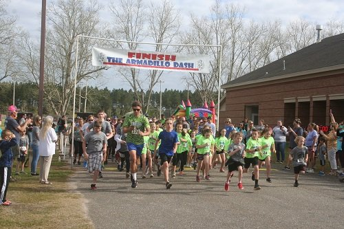 On your mark, get set, race! Runners take off at the start of last year's Armadillo Dash at Rosinton School. This year's race will be held March 7.