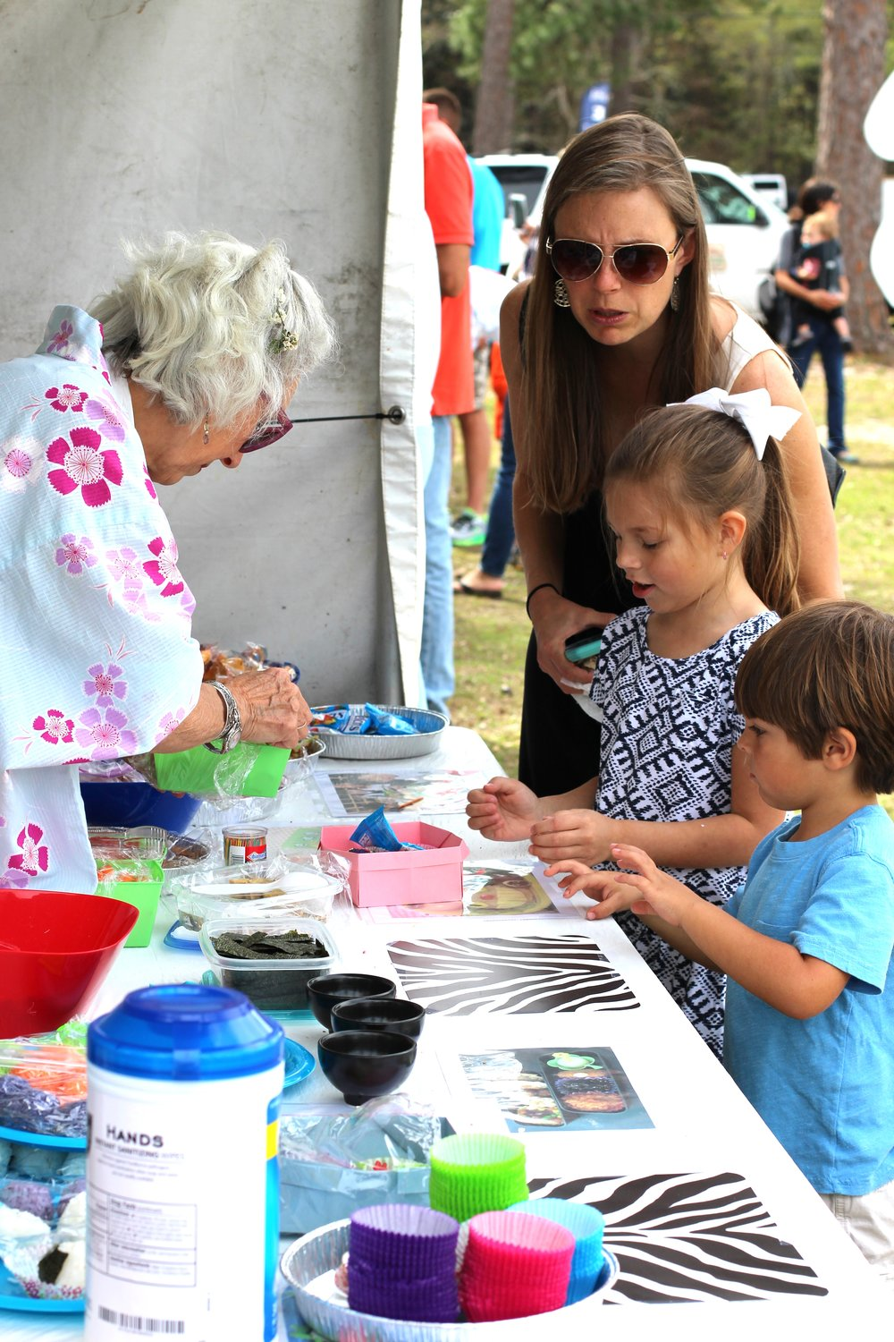Kids' Art Alley offers young festival goers plenty of hands-on fun. Children can dig their fingers into clay, make sand art, enjoy games, watch live demonstrations and take home their own works of art.