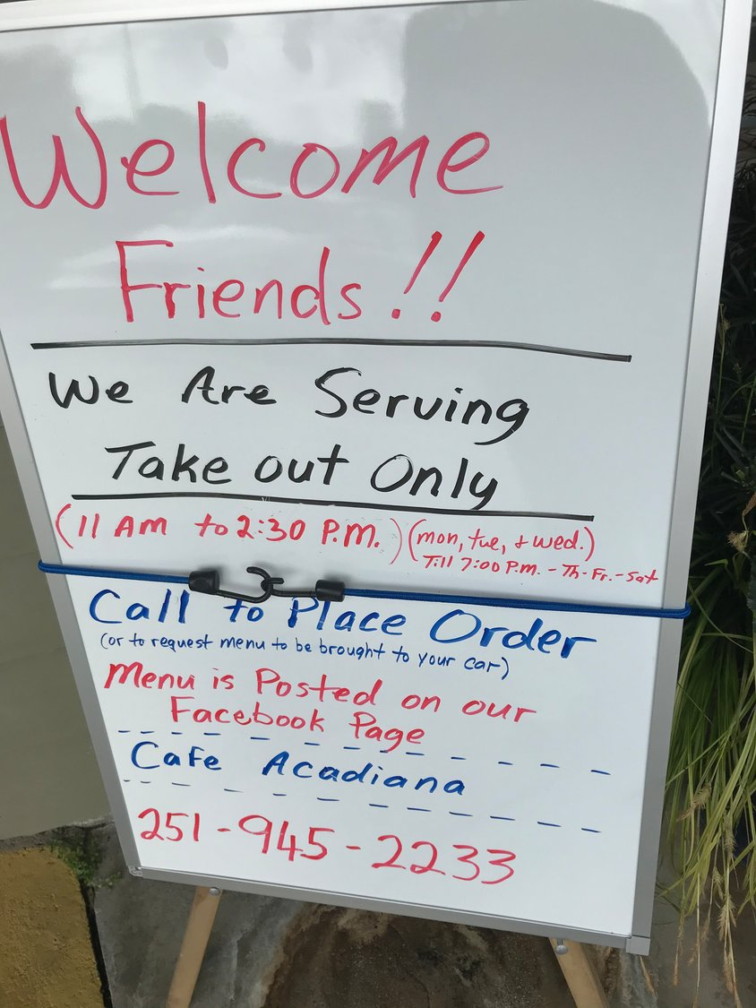 A sign announces that Café Acadiana in Silverhill is serving only take-out meals. Restaurants in Baldwin County and across Alabama are serving only take-out meals or closing since Gov. Kay Ivey prohibited dining in establishments to slow the spread of the coronavirus.