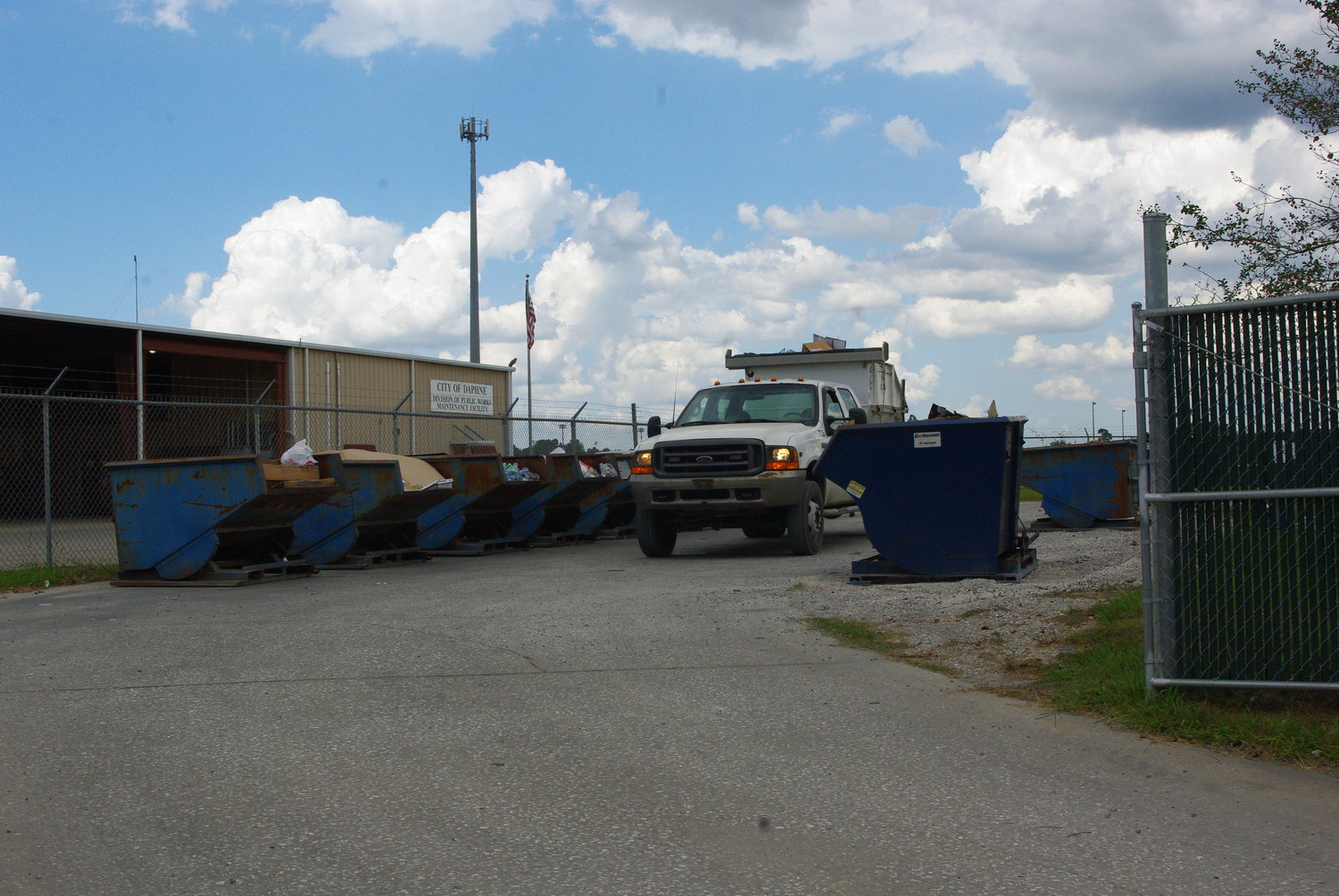 A Daphne recycling truck works at the city Solid Waste Department before the recycling drop-off location was closed.