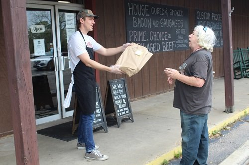 An employee serves a customer at Farm Fresh Meats in Robertsdale.