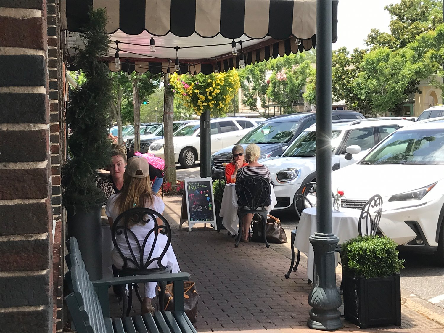 Restaurant visitors dine on the sidewalk on Fairhope Avenue. The Fairhope City Council is considering opening more sidewalk space and some parking areas to allow restaurants to provide more room to accommodate social distancing requirements.