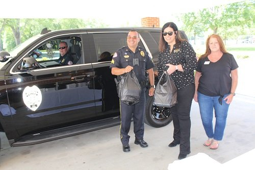 County Commission Chairman Billie Jo Underwood assisted in providing meals for first responders at the annual Central Baldwin Chamber of Commerce Honoring Our Heroes lunch held Tuesday, May 12 at the Robertsdale Church of Christ. Underwood is shown here with Chamber President/CEO Gail Quezada delivering to her hometown Summerdale Police Department.
