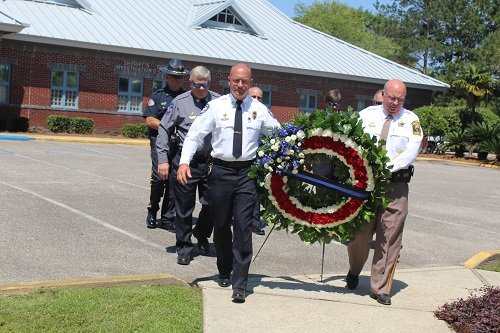 Baldwin County Sheriff Hoss Mack, right, and Bay Minette Police Chief Al Tolbert, carry a wreath placed Tuesday, May 12 at the Baldwin County Sheriff's Department Law Enforcement Officers Memorial in Robertsdale.