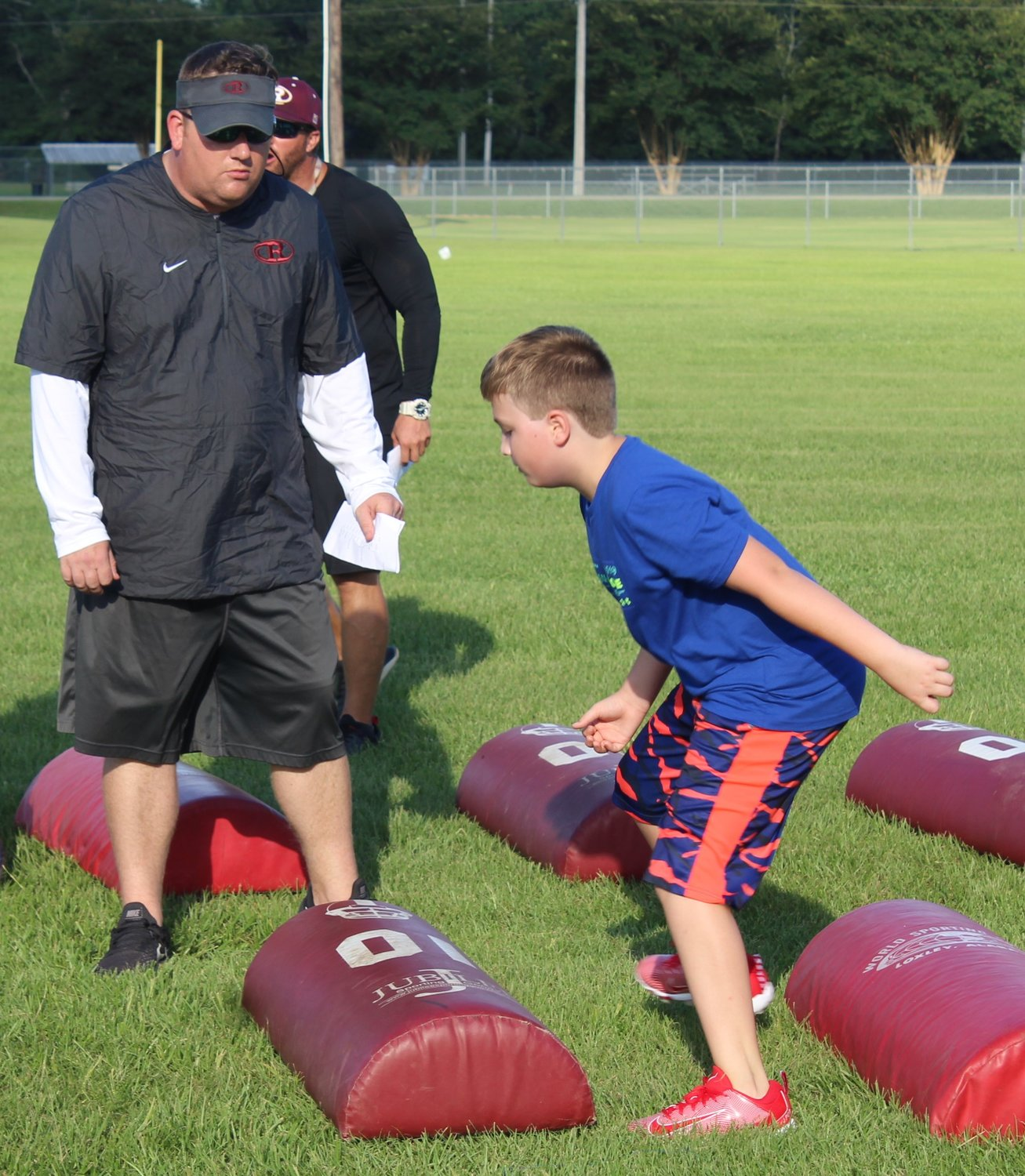 RHS Head Football Coach/Athletic Director Kyle Stanford held his first camp last summer at Garrett Park.