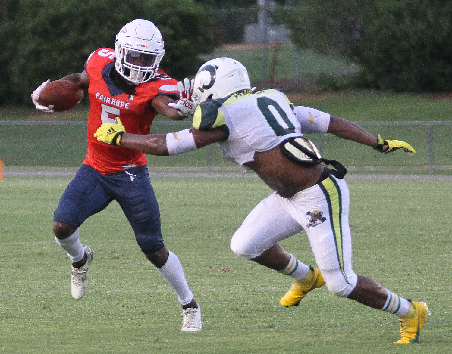 Darius Powell (5) of the Storm stiff arms Roderick Mckenzie of the Rams at Fairhope Saturday.