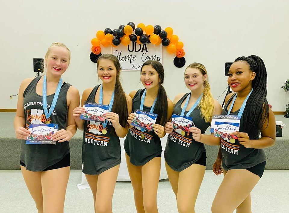 Sara Munson (Freshman), Allison Smith (Sophomore), Emma Quezada (Senior), Morgan Bright (Senior), and Brasia Banks (Senior) earned the distinguished title of UDA All-American and will get the opportunity to travel to London for their New Year's Day Parade.