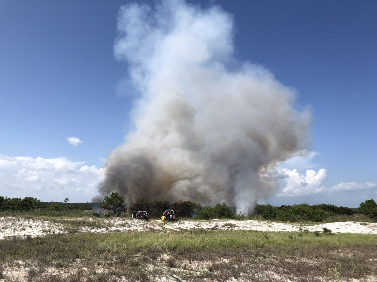 The brush fire started in the 500 block of Perdido Beach Boulevard and quickly moved north toward marshland.