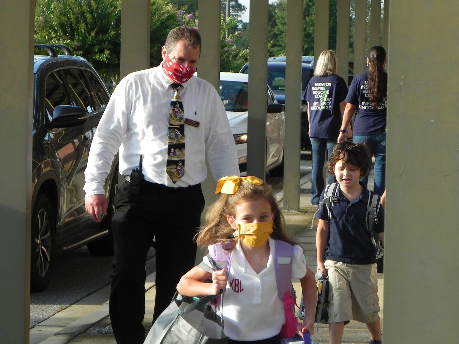 Robertsdale Elementary School Assistant Principal Robert Weichert greets students on the first day of school Wednesday.