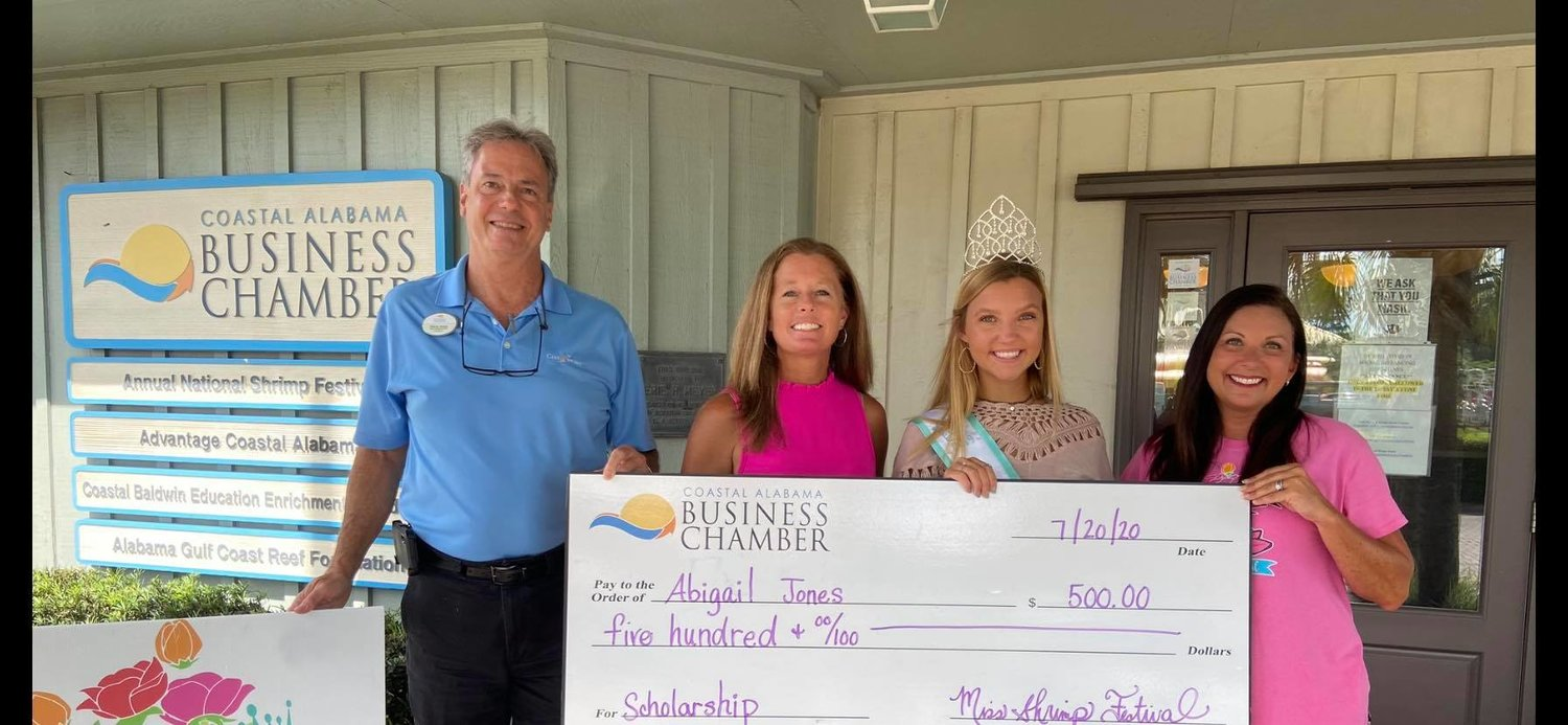 Miss Shrimp Festival 2019 and recent Gulf Shores High School graduate Abigail Jones excepts her $500 scholarship to the University of Alabama.