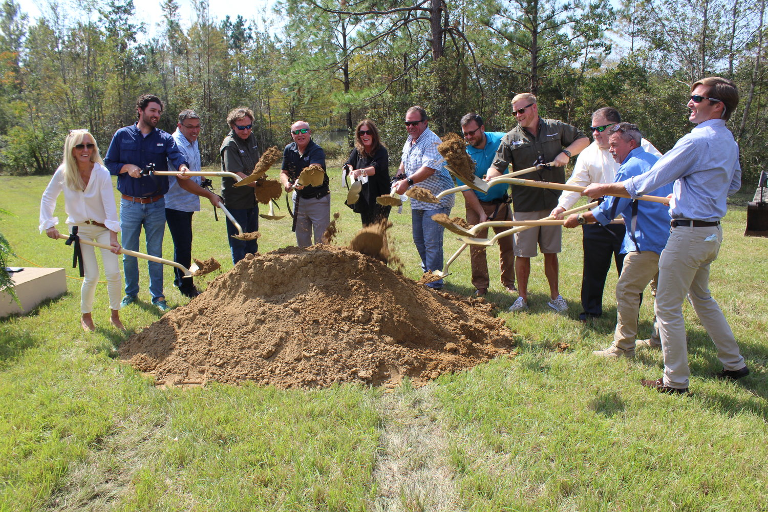 Officials, staff members and board members with Youth-Gulf Coast break ground on a new transitional living home on Monday, Oct. 12 at the facility located east of Summerdale.