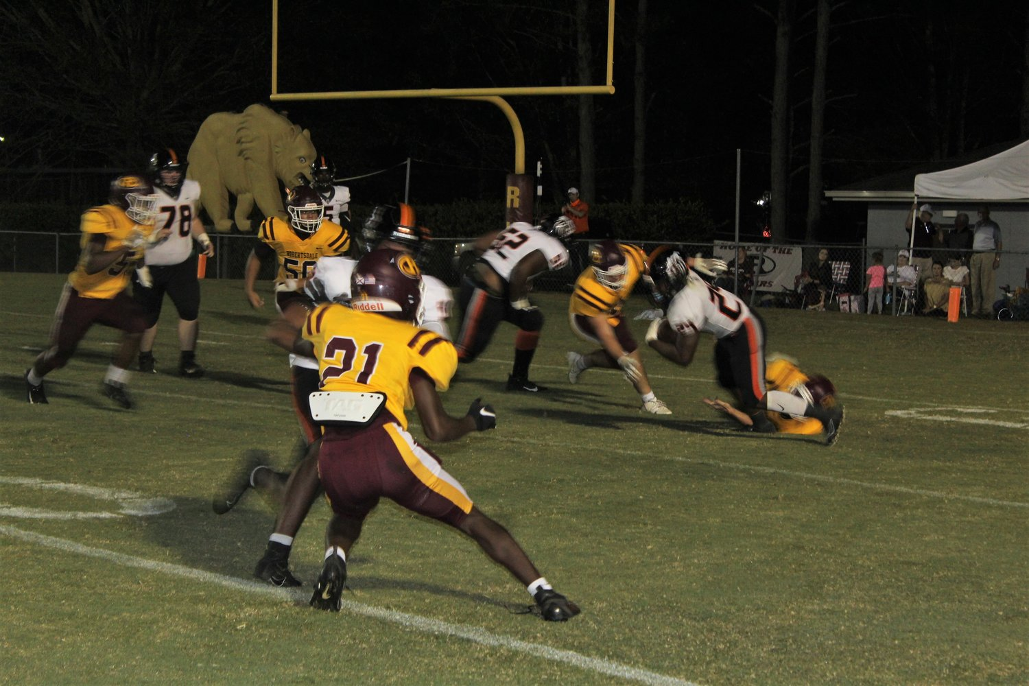 A host of Bear tacklers leave BCHS sophomore running back Jicaris Baldwin (24) nowhere to run Friday night at J.D. Sellars Stadium in Robertsdale.