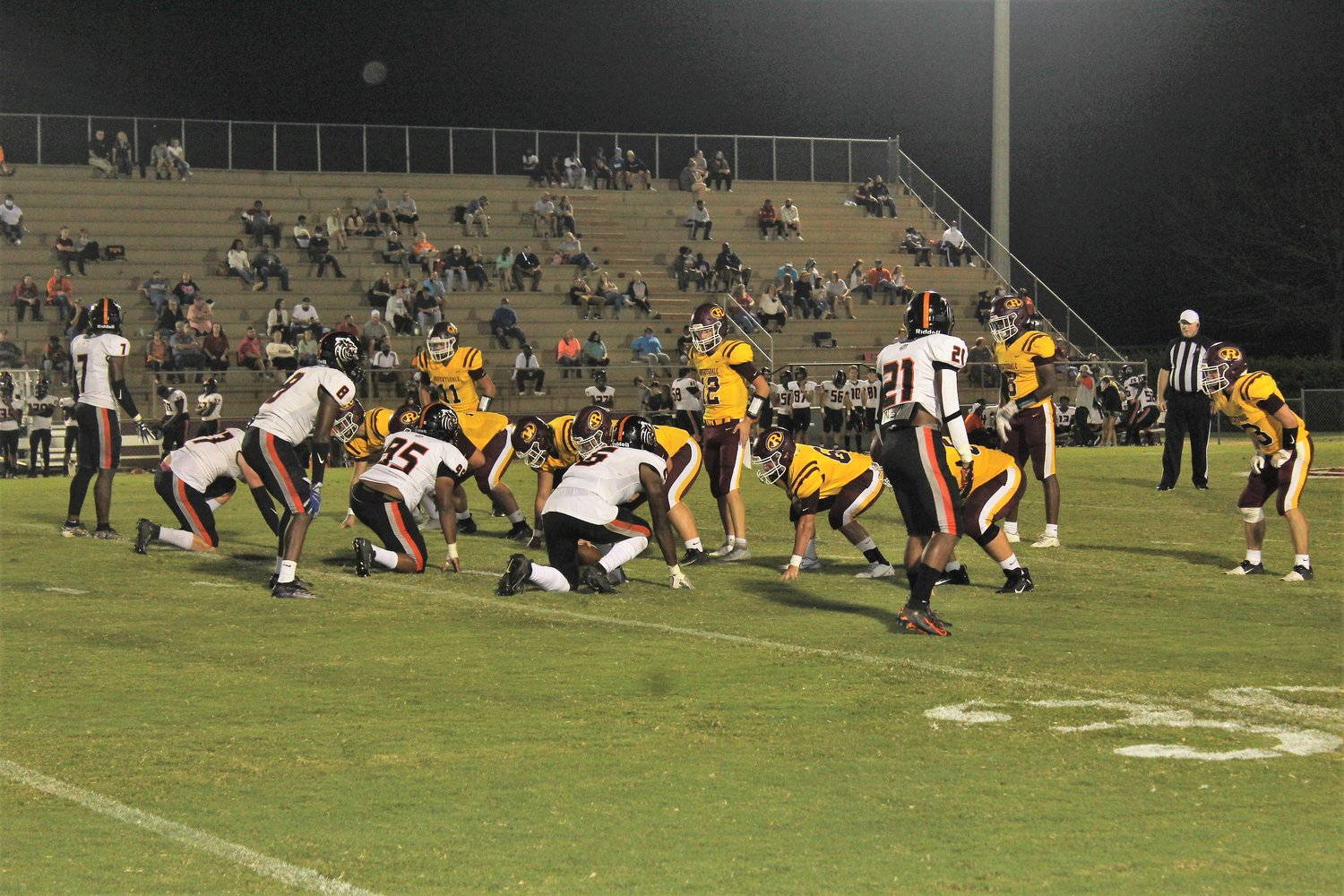 Senior quarterback Grant Driver (12) and the Robertsdale Golden Bears line up against the Baldwin County High Tigers Friday night at J.D. Sellars Stadium in Robertsdale.