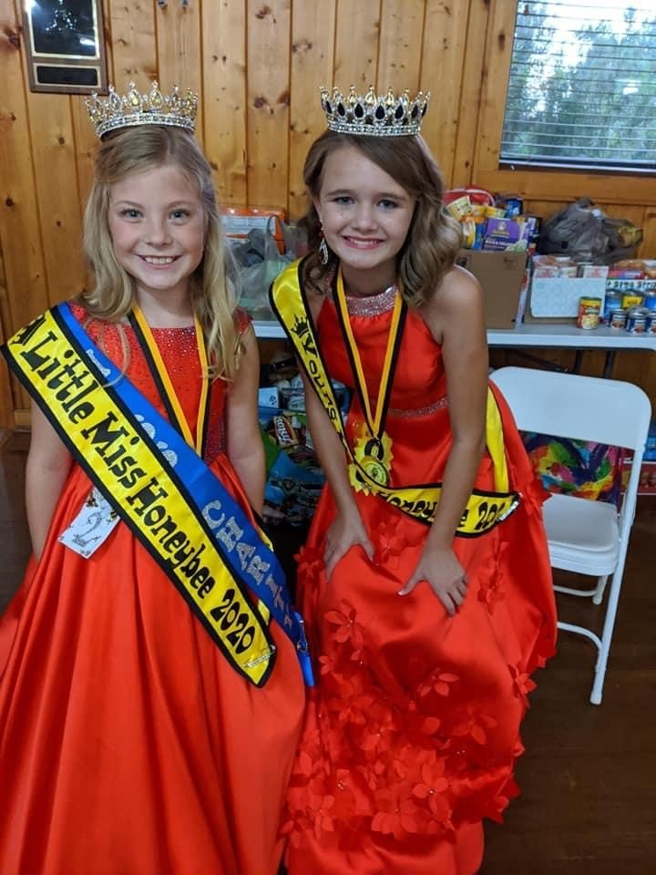Little Miss HoneyBee Brenna Schmierer and Young Miss HoneyBee Jorja Corrino. Brenna Schmierer was also named Miss Charity, collecting more than 6,000 food items alone.