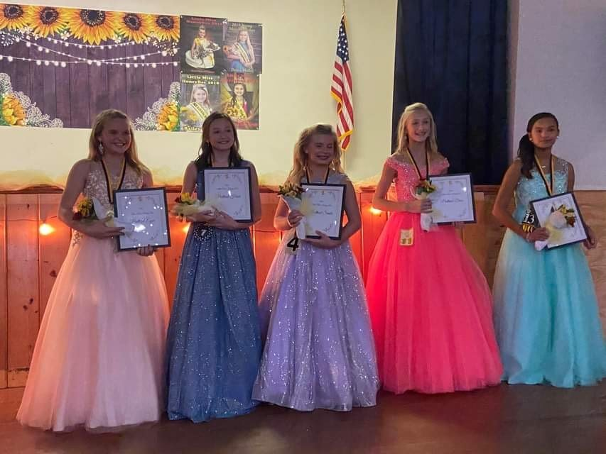 Extra title winners, in no order, Julianna Pfeiffer, Prettiest Hair; Eleanor McCoy, Prettiest Dress; Khloe Doffee, Prettiest Decorated Number; Emme Kate Lynn, Prettiest Eyes; and Marley Powell, Prettiest Smile.
