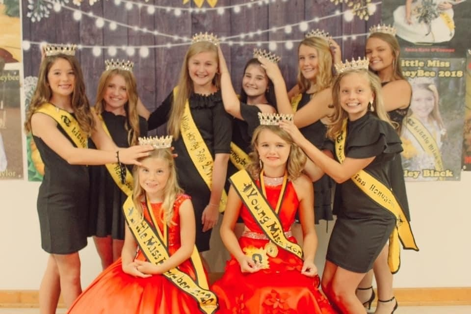 Little Miss HoneyBee title winners from past years pass the crown to this year's winners Little Miss HoneyBee Brenna Schmierer and Young Miss HoneyBee Jorja Carrino.