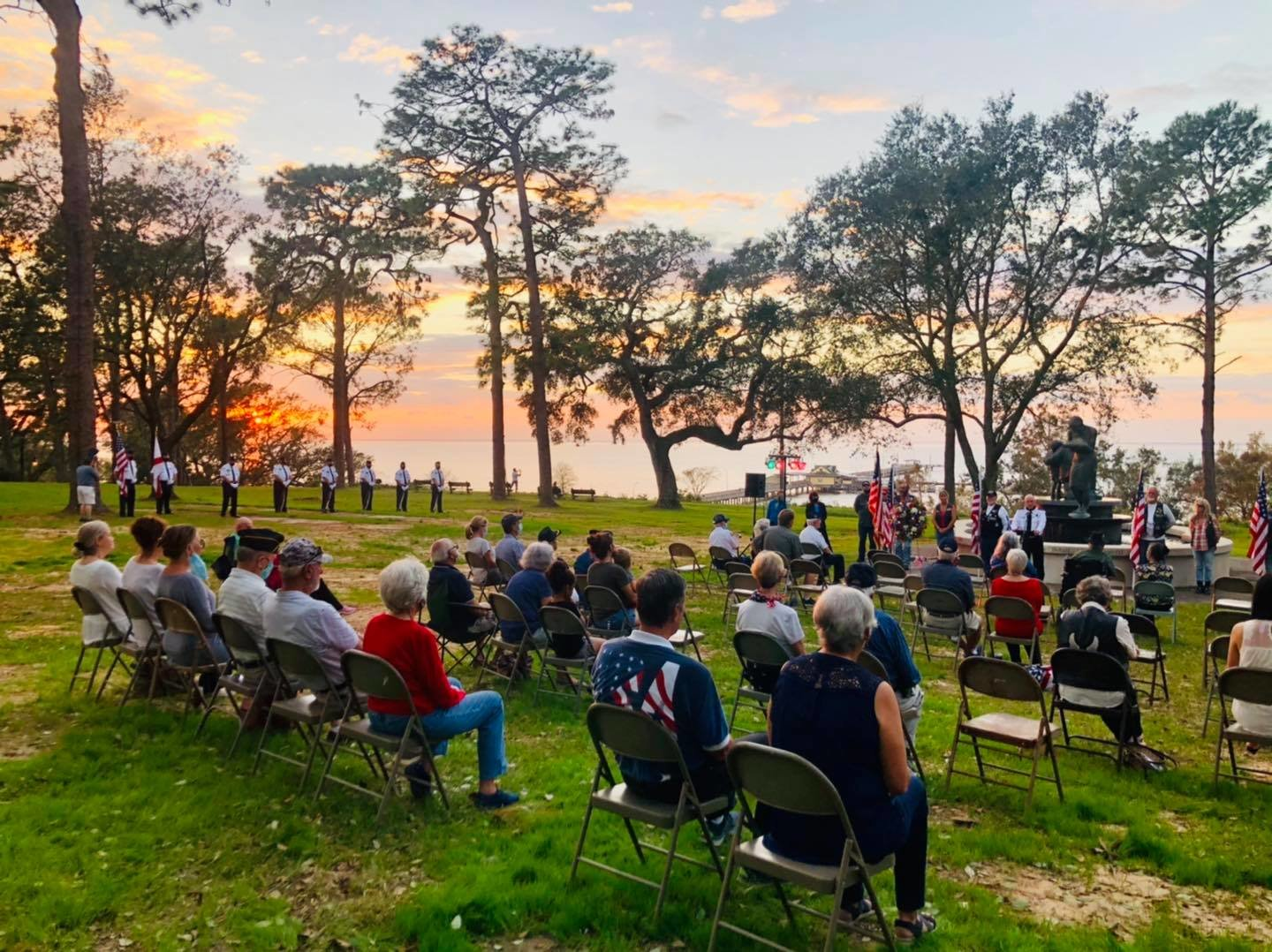 Residents take part in a Veterans Day service at Henry George Park in Fairhope on Wednesday, Nov. 11.