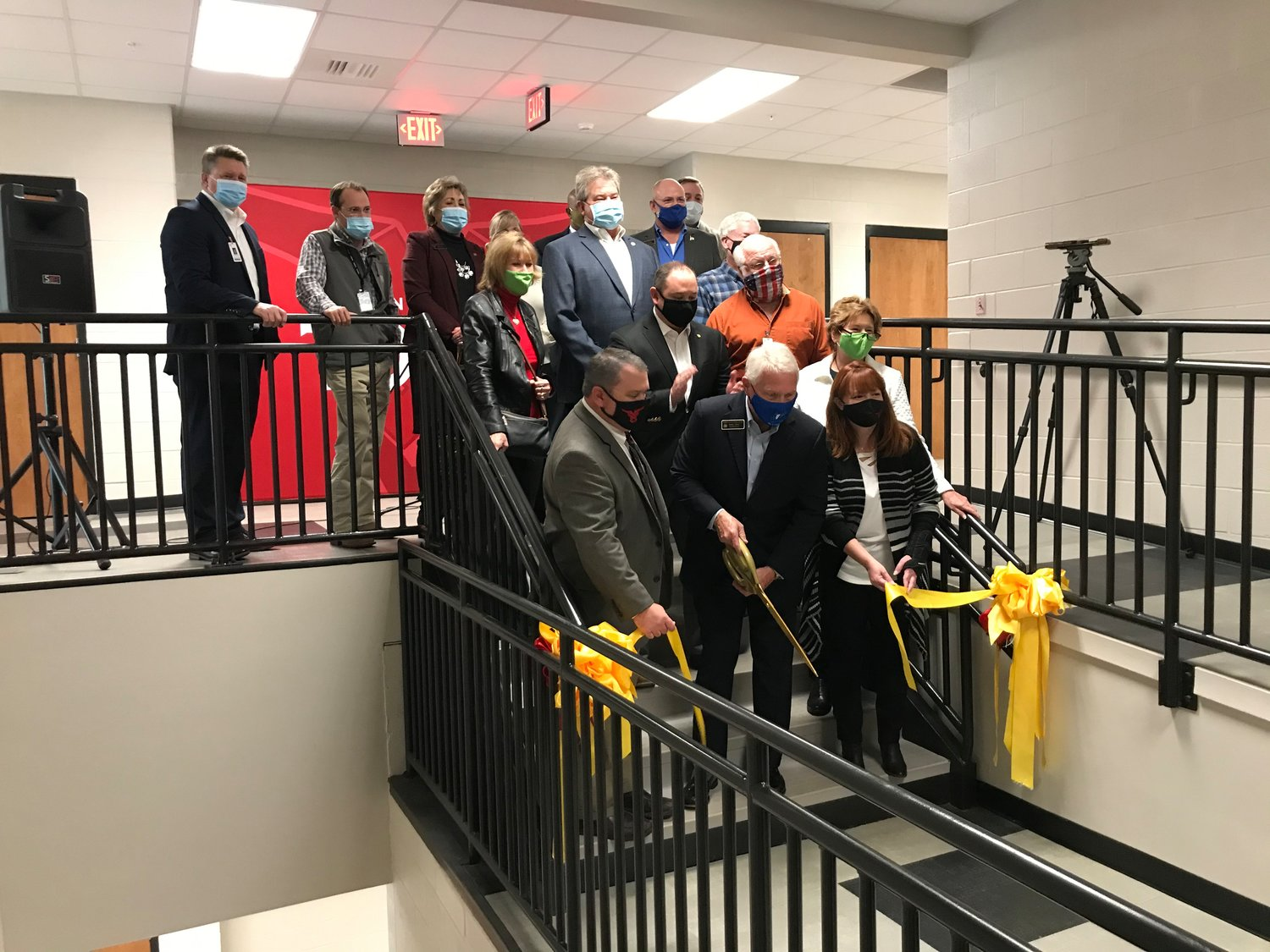 Officials cut the ribbon for the new wing at Spanish Fort High School.