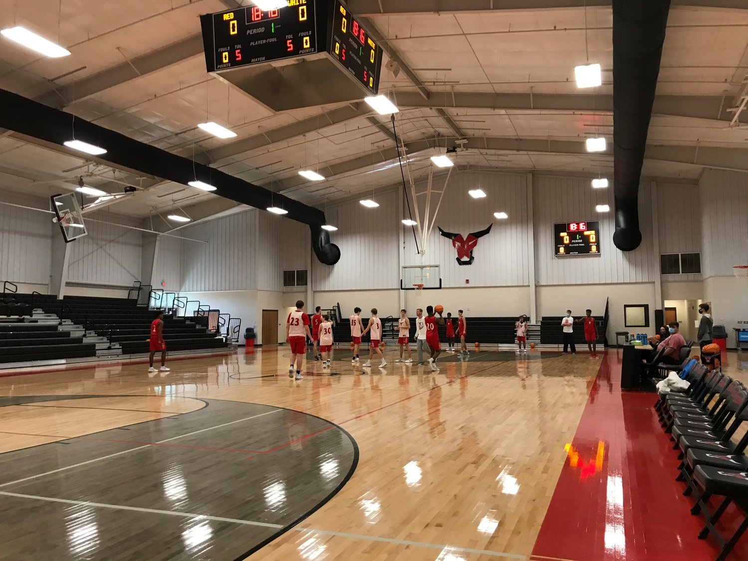 Basketball players practice in the new gymnasium at Spanish Fort High School.