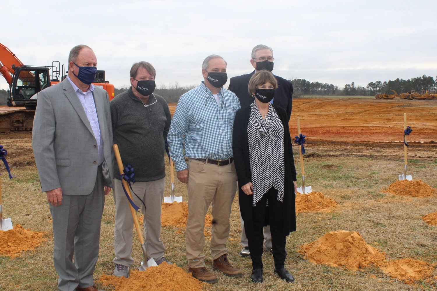 Loxley Mayor Richard Teal, far left, is joined by council members, from left, Lee Wilson, Mayor Pro Tem Kasey Childress, Katherine Breeden and Jeff Knight following the ALDI groundbreaking ceremony on Feb. 10. Not pictured is Council member Chris McCall.