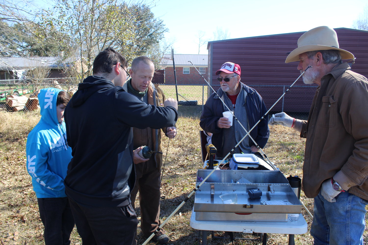 Program Director Clyde Myrick teaches the proper way to load and untangle fishing line during the Kids Outdoor Zone program held Feb. 20 at FBC-Robertsdale.