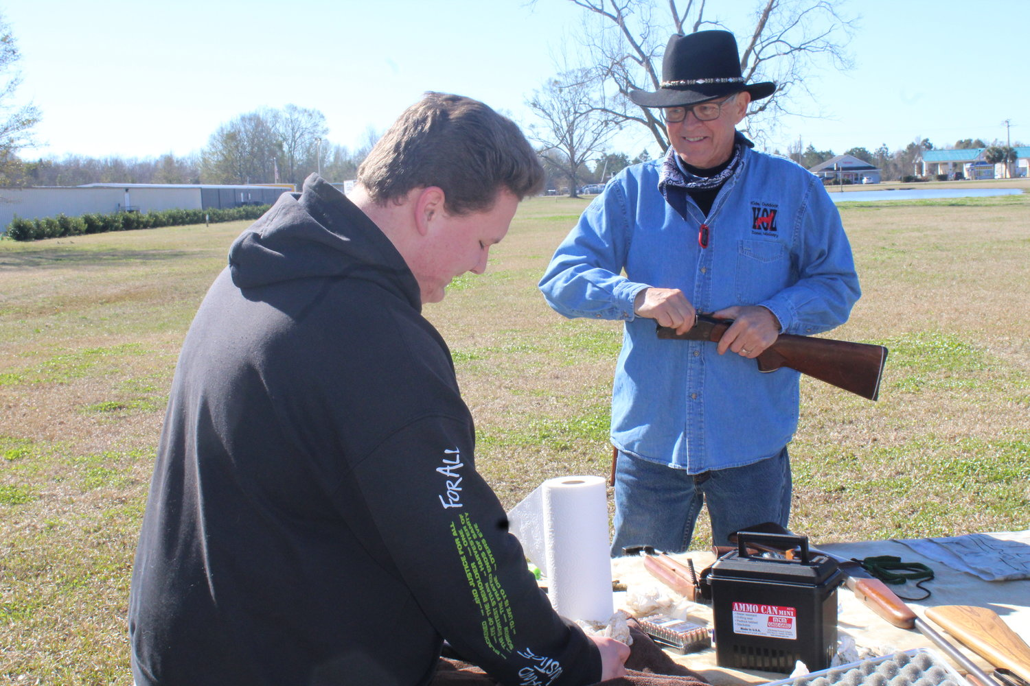Ronnie Hall, who helped bring the Kids Outdoor Zone program to FBC-Robertsdale, teaches proper gun cleaning techniques.