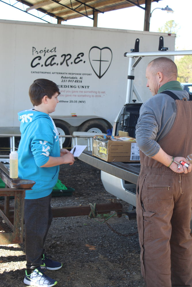 KOZ of FBC-Robertsdale Director Clyde Myrick talks with a Kids Outdoor Zone program participant following the Feb. 20 program.