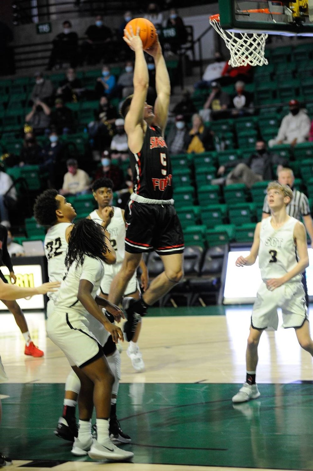Cameron Keshock (5) of Spanish Fort jumps high for a bucket in the Toros' 65-61 Class 6A semifinal win at Bartow Arena.
