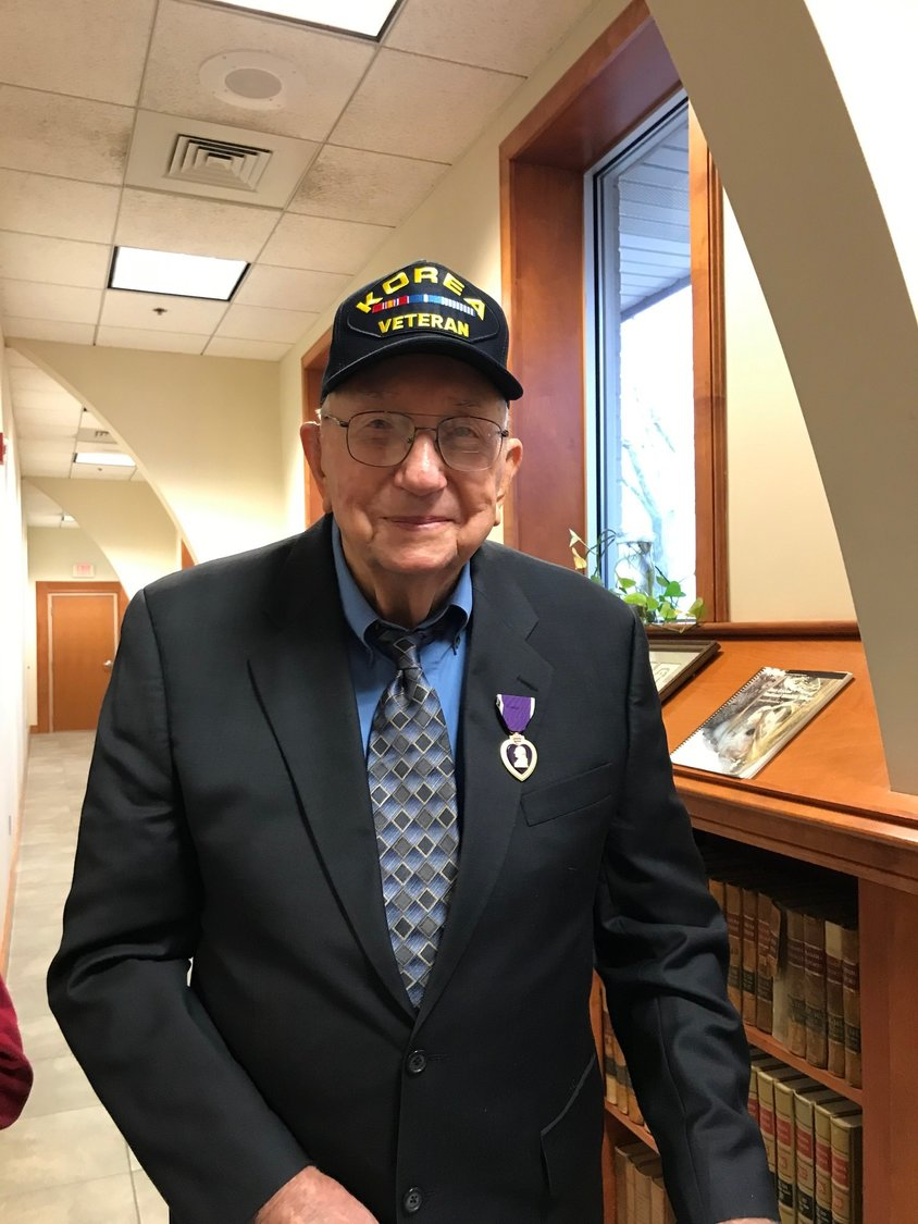 Bill Silcox of Robertsdale wears the Purple Heart medal he received Tuesday, 69 years after being wounded in the Korean War.