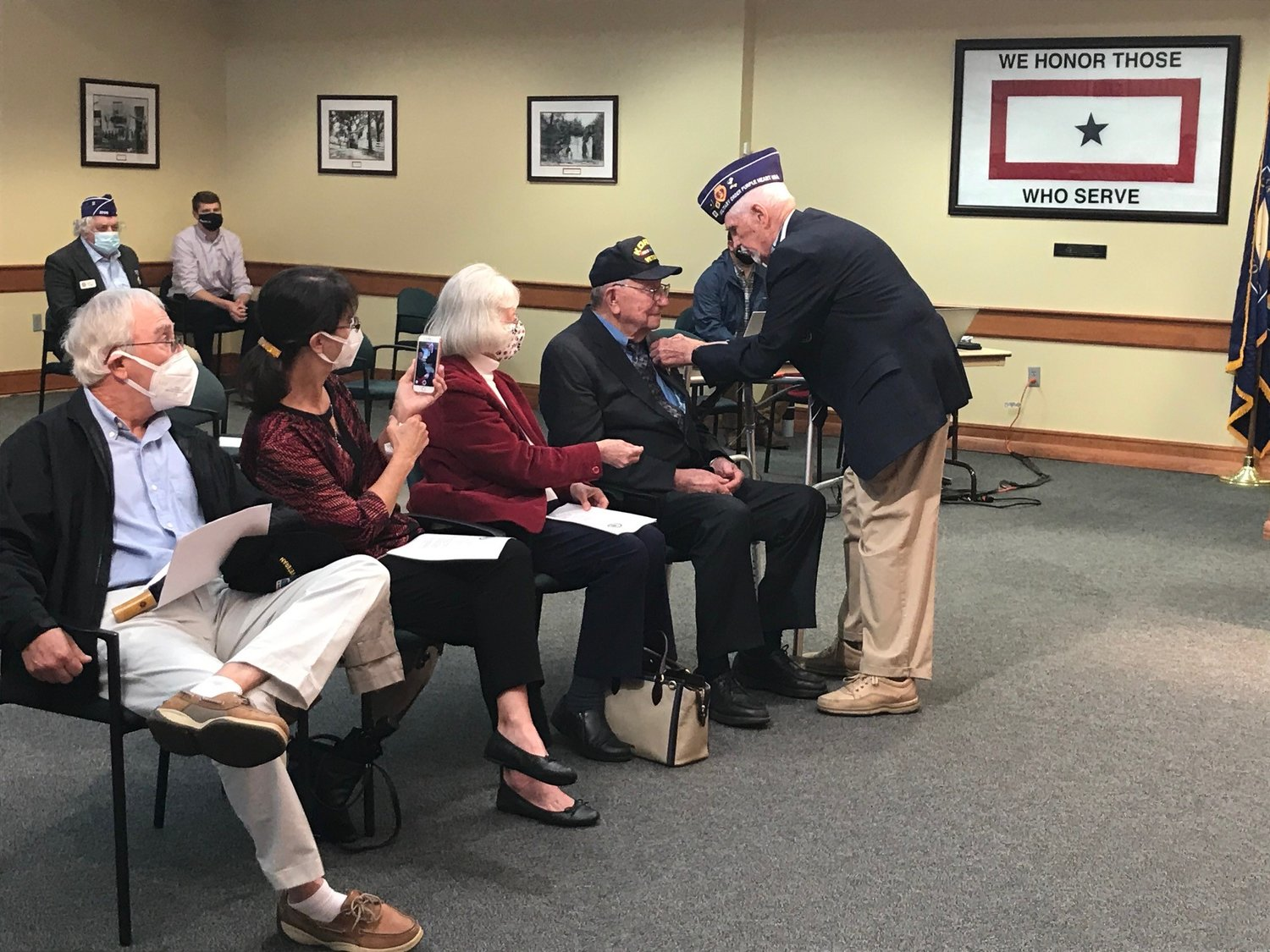Bill Silcox receives his Purple Heart medal almost 69 years after being wounded in the Korean War.