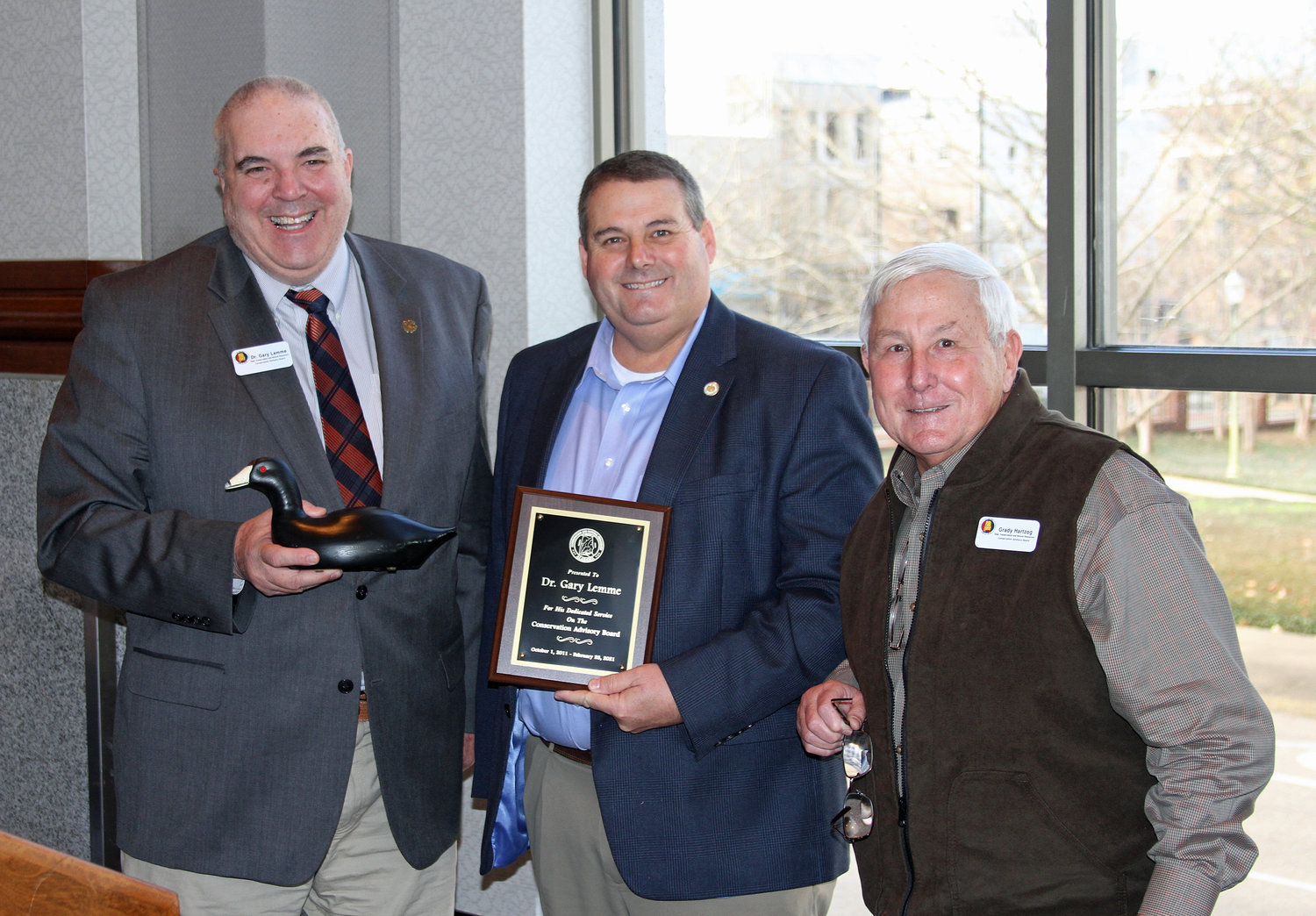 Dr. Gary Lemme, left, was recognized for his service on the Alabama Conservation Advisory Board by Conservation Commissioner Chris Blankenship and Grady Hartzog, right.