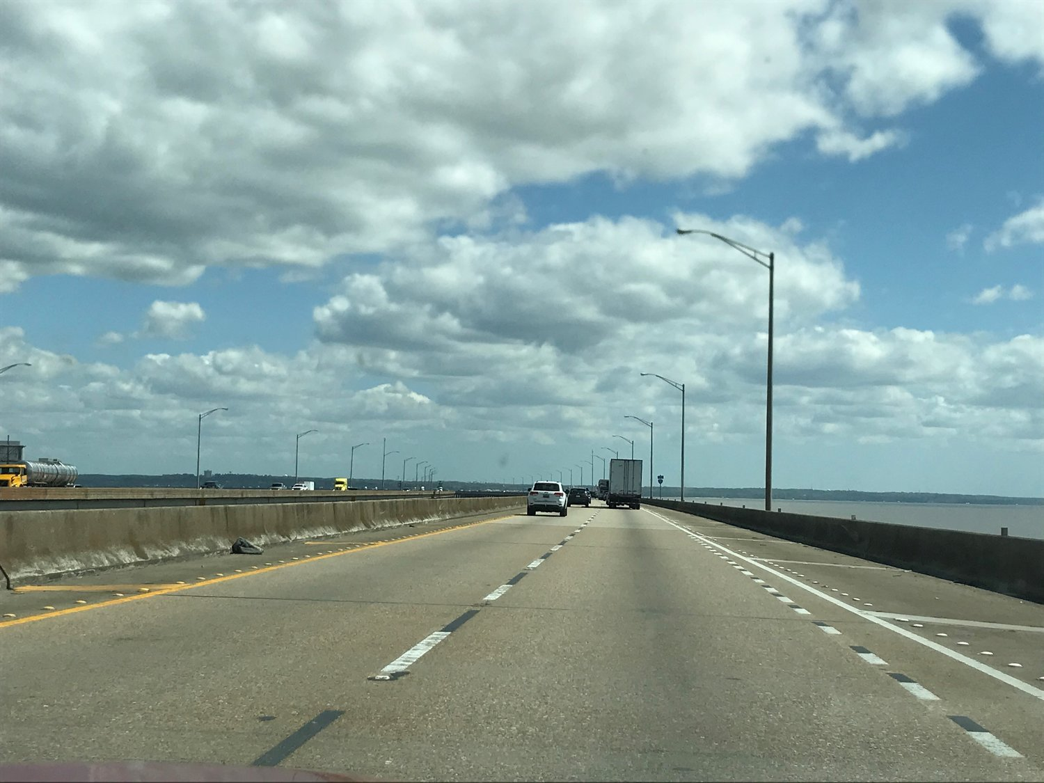 A new proposal for reducing congestion on the Interstate 10 Bayway would have the highway restriped to add a third lane in each direction without modifying the structure.