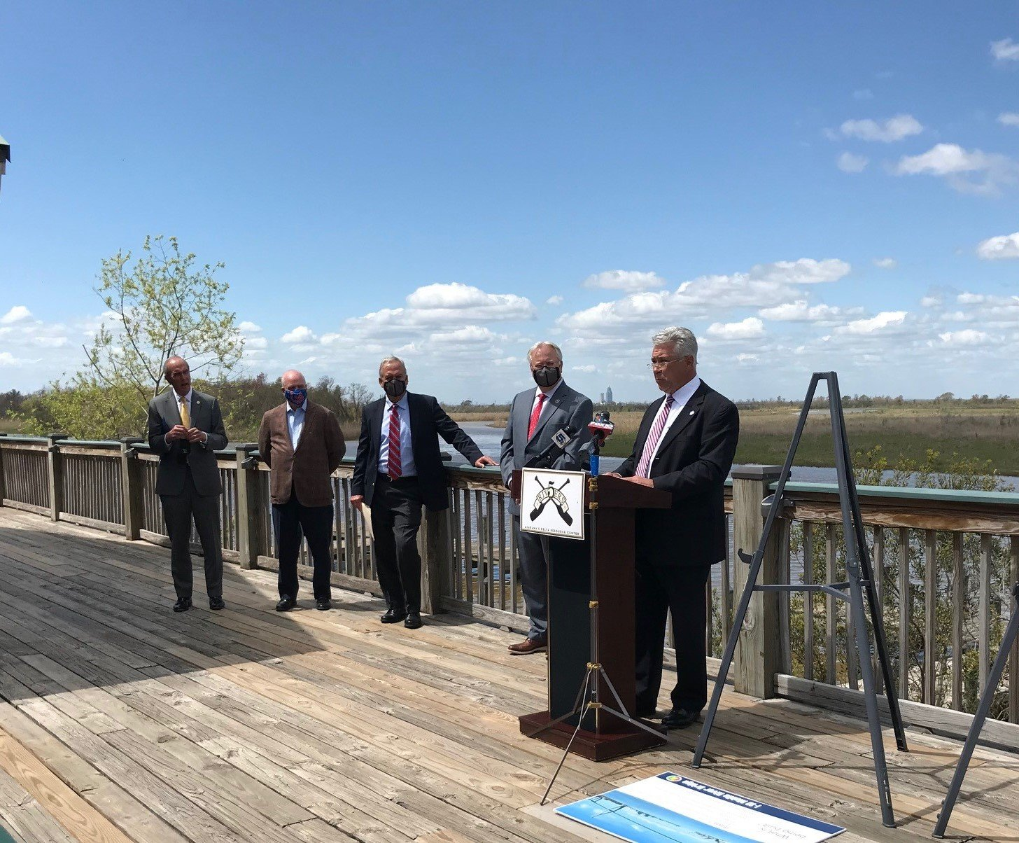 Fairhope City Council President Jack Burrell, Mobile Mayor Sandy Stimpson, U.S. Rep. Jerry Carl and other officials address the public during an announcement of a new bridge and Bayway improvements Monday.
